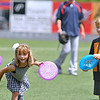Brad Davis/The Register-Herald<br /> Seven-year-old Anna Davis shows proper mechanics as she sends her frisbee sailing to its target while competing against her friend Smyth Brown, also seven, in a between-innings frisbee golf challenge at the West Virginia Miners playoff game Sunday afternoon at Linda K. Epling Stadium.