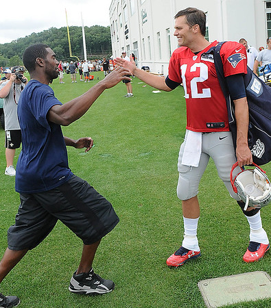 Rick Barbero/The Register-Herald<br /> Tom Brady, of New England, right, greets former NFL star Randay Moss after the New Orleans Saints and New England Patriots joint practice held at The Greenbrier Resort in White Sulphur Springs Thursday morning.
