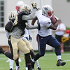 Rick Barbero/The Register-Herald<br /> Devin McCourty, of New England breaks away from a couple Saints defenders during the New Orleans Saints and New England Patriots joint practice held at The Greenbrier Resort in White Sulphur Springs Thursday morning.