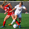 Brad Davis/The Register-Herald<br /> Woodrow Wilson's Kailee Varney battles for possession with Hurricane's Ann-Marie Ramey Thursday evening at the YMCA Paul Cline Memorial Sports Complex.
