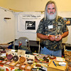 Brad Davis/The Register-Herald<br /> Local handcrafted custom turkey call maker Ben Dameron poses for a quick photo at the Lost Calls Turkey Calls booth inside the Beckley-Raleigh County Convention Center Saturday afternoon during the Appalachian Arts & Crafts Fair.
