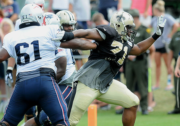 Rick Barbero/The Register-Herald<br /> Kaleb Eulls, of the Saints, breaking through some Patriots blockers during the New Orleans Saints and New England Patriots joint practice held at The Greenbrier Resort in White Sulphur Springs Wednesday morning.