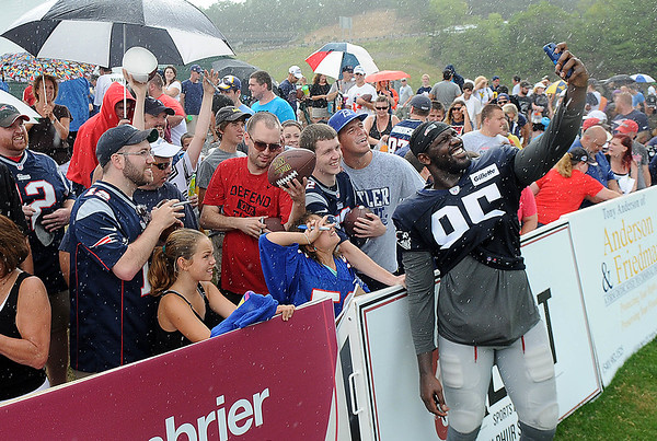 Rick Barbero/The Register-Herald<br /> Chandler Jones takes a selfie during the autograph session after the New Orleans Saints and New England Patriots joint practice held at The Greenbrier Resort in White Sulphur Springs Wednesday morning.