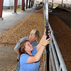 Brad Davis/The Register-Herald<br /> Exchange residents Jennifer Friend and David Friend of Friend Brothers Limousin prepare the area where their cattle will be displayed in the livestock arena section of the State Fairgrounds Wednesday afternoon in Fairlea.