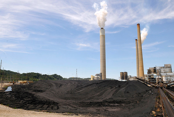 Brad Davis/The Register-Herald<br /> Tons of crushed coal unloaded from rail cars and barges sits on hand at John Amos power plant in Winfield. From here it will travel by conveyer into a series of pulverizers before being injected as a fine dust into massive boiler units.