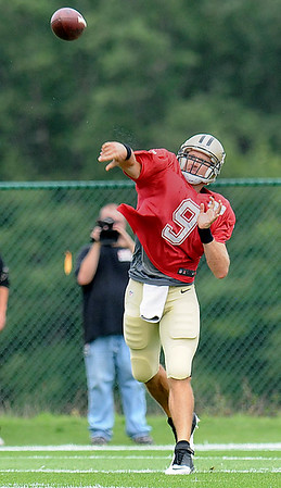 Rick Barbero/The Register-Herald<br /> Drew Bress, of the Saints, tosses a pass during the New Orleans Saints and New England Patriots joint practice held at The Greenbrier Resort in White Sulphur Springs Wednesday morning.