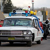 """Passengers of """"Ecto-1"""" from the Ghostbusters toss candy to parade goers during the annual Sophia Christmas parade on Saturday. There were around 20 different entrees into the parade."""