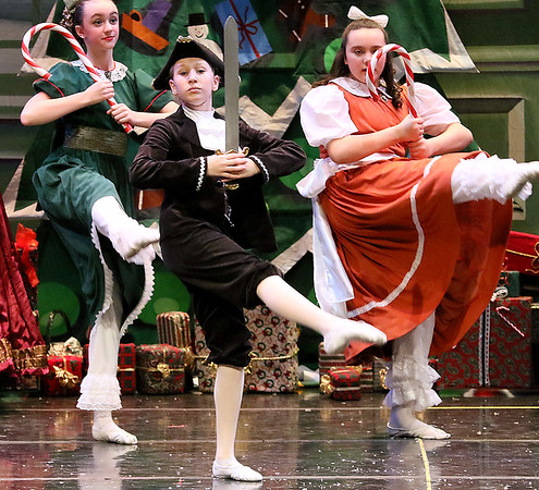 Brad Davis/The Register-Herald<br /> Fritz (nearest), played by Ashtin Bailey, dances during the party portion of Beckley Dance Theatre's The Nutcracker Sunday afternoon inside the Woodrow Wilson High School Auditorium.