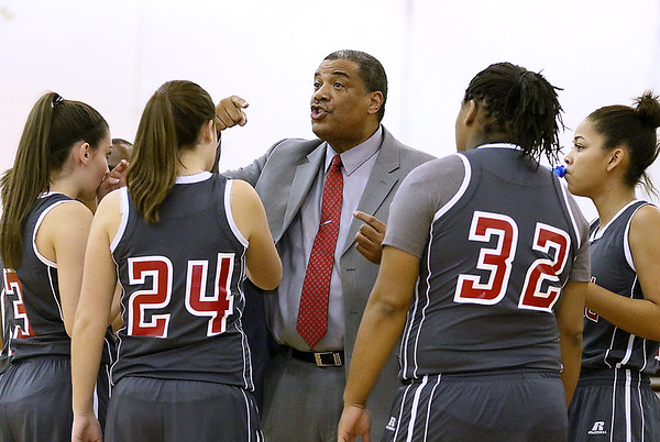 Brad Davis/The Register-Herald<br /> Oak Hill girls basketball coach Marshall Murray instructs his team during a timeout at Woodrow Wilson December 2 in Beckley.
