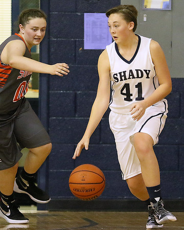 Brad Davis/The Register-Herald<br /> Shady Spring's Whitney Cromer looks for an open teammate as she dribbles during a home game against Summers County December 3.