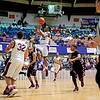 Woodrow's Ty Walton (12) attempts a jumper late in the second quarter of the Battle for the Armory Championship Game against George Washington at the Beckley-Raleigh County Armory in Beckley on Tuesday.
