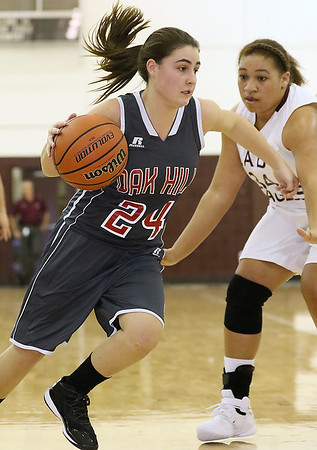Brad Davis/The Register-Herald<br /> Oak Hill's Madison Lilly drives during a game at Woodrow Wilson December 2.