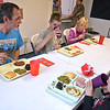 Brad Davis/The Register-Herald<br /> William Young, left, and his 6-year-old son Gaven (lower right), 12-year-old son Charles and 8-year-old daughter Angel enjoy a Christmas dinner together at the Pinehaven Center Friday afternoon.