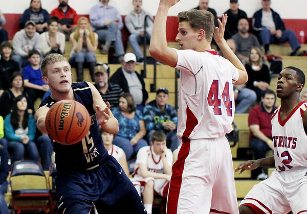 Greenbrier West's Hunter Yates (15) passes past Independecne's Aaron Hunt (44) during the second quarter of their basketball game Friday in Coal City.