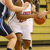 Brad Davis/The Register-Herald<br /> Liberty's Jasmine Law drives to the basket during a home game against Meadow Bridge December 4 in Glen Daniel.