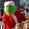 Brad Davis/The Register-Herald<br /> The Grinch didn't steal the Beckley Christmas Parade, but he certainly seemed to enjoy being a part of it Saturday afternoon.