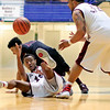 Woodrow Wilson's Tyriek Walton (12) passes to Tarek Payne (32) as George Washignton's (10) during the second quarter of the Battle for the Armory Championship Game at the Beckley-Raleigh County Armory in Beckley on Tuesday.