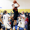 Chris Jackson/The Register-Herald<br /> Summers County's Dacota Thomas (35) grabs a rebound over tow Shady Spring's Keith Sexton (1) and Jonathan Sawyer (0) during the first half of their basketball game Thursday at Shady Spring.