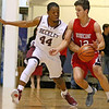 Brad Davis/The Register-Herald<br /> Woodrow Wilson's Nequan Carrington reaches in to steal the ball away from Hurricane's Ryan Midkiff during the Flying Eagles' win over the Redskins Friday night at the Beckley-Raleigh County Convention Center.