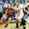 Summers County's Whittney Justice (32) drives past  Chapmanville's Lexi Hines (32) during the championship game of Rogers Oil Classic at Summers County High School in Hinton on Saturday.