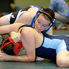 Brad Davis/The Register-Herald<br /> Beckley-Stratton's Kolten Ray (above) takes on Eastern Greenbrier Middle's Nicholas Hendrix in a 155-pound weight class matchup during the Wayne Bennett Invitational Saturday morning at Park Middle School. Ray would go on to win the match.