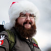 Dave Humphrey's, from Charleston, dressed as a Ghostbuster, smiles at parade goers during the annual Sophia Christmas parade on Saturday. There were around 20 different entrees into the parade.