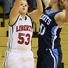 Brad Davis/The Register-Herald<br /> Liberty's Jamie Wood shoots from three-point range during a home game against Meadow Bridge December 4 in Glen Daniel.