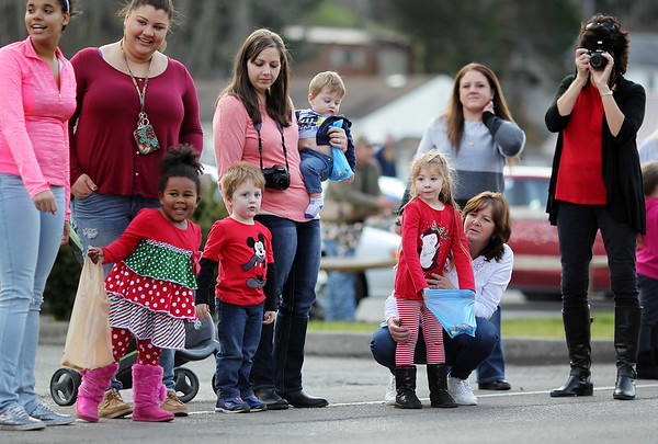 Parade goers look on during the annual Sophia Christmas parade on Saturday. There were around 20 different entrees into the parade.