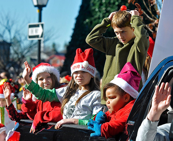 Brad Davis/The Register-Herald<br /> Participating youngsters wave to the crowd during Beckley's annual Christmas Parade Saturday.