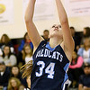 Brad Davis/The Register-Herald<br /> Meadow Bridge's Shauna Harless drives and scores during a game at Liberty December 4 in Glen Daniel.