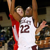 Brad Davis/The Register-Herald<br /> Woodrow Wilson's Isaiah Francis drives and scores as Hurricane's Braxton Dobert defends during the Flying Eagles' win over the Redskins Friday night at the Beckley-Raleigh County Convention Center.