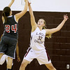Brad Davis/The Register-Herald<br /> Woodrow Wilson's Savannah Holstein defends against Oak Hill shooter Madison Lilly during a home game against the Red Devils December 2.