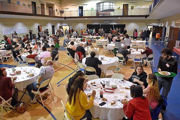 Brad Davis/The Register-Herald<br /> The scene during United Methodist Temple's annual community Christmas dinner Friday morning inside The Place.