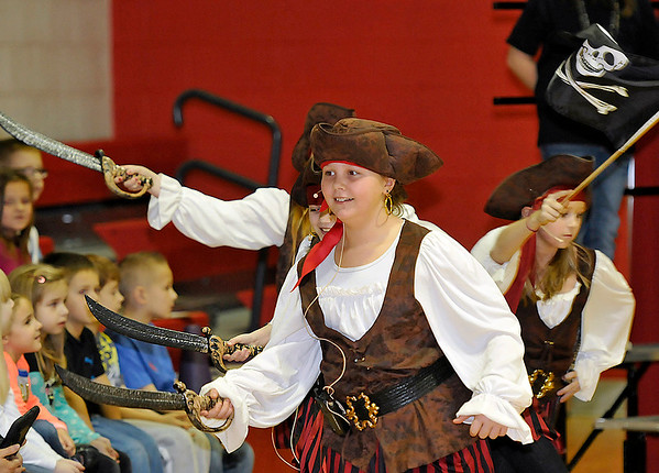 """Brad Davis/The Register-Herald<br /> Marauding young pirates burst into the scene during Fairdale Elementary's annual Christmas play, """"A Pirate Christmas,"""" Friday afternoon in the school's gymnasium."""