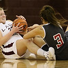 Brad Davis/The Register-Herald<br /> Woodrow Wilson's Paige Lewis battles for a loose ball with Oak Hill's Caclea Teal during the Lady Eagles' win over the Red Devils Wednesday night in Beckley.