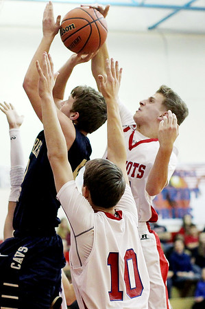 Independence's  Aaron Hunt (44)  blocks a shot from Greenbrier West's Adam Johnson (50) during the second quarter of their basketball game Friday in Coal City.