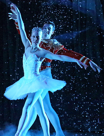 Brad Davis/The Register-Herald<br /> The Nutcracker Prince, performed by Gregory Brown, and Snow Queen, performed by Michelle Joy, dance through a scene in The Kingdom of Snow portion of Beckley Dance Theatre's The Nutcracker Sunday afternoon inside the Woodrow Wilson High School Auditorium.