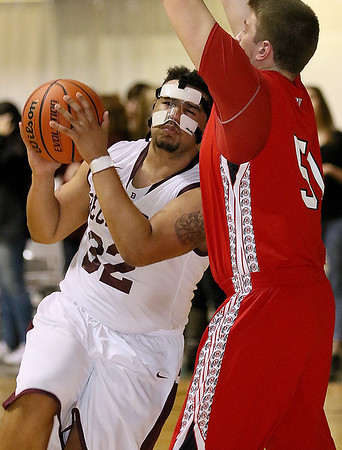 Brad Davis/The Register-Herald<br /> Woodrow Wilson's Tarek Payne drives and scores as Hurricane's Jacob Lawrence defends during the Flying Eagles' win over the Redskins Friday night at the Beckley-Raleigh County Convention Center.