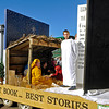 Brad Davis/The Register-Herald<br /> Youths from Glen Morgan Missionary Baptist Church ride on their float, which featured a massive bible, nativity scene and what appeared to be a living room at Christmas time during Beckley's annual Christmas Parade Saturday.