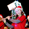 Chris Jackson/The Register-Herald<br /> Members of the Collins Middle School Little Devil Marching Band perform during the annual Christmas parade in Oak Hill on Thursday.