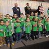 """YMCA Happy Kids Preschool does the Pledge of Allegiance during the """"Spirit of Beckley"""" awards fundraiser dinner held at the Beckley-Raleigh County Convention Center Monday night. This year's award recipient was the late Mel Hancock."""