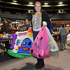 Brad Davis/The Register-Herald<br /> Beckley resident Kelly Norris sets off with a bounty of Christmas gifts during Mac's Toy Fund Party Saturday morning at the Beckley-Raleigh County Convention Center.