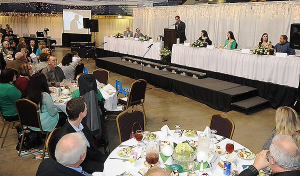 """Jay Rist, YMCA CEO, speaks during the """"Spirit of Beckley"""" awards fundraiser dinner held at the Beckley-Raleigh County Convention Center Monday night. This year's award recipient was the late Mel Hancock."""