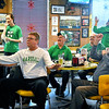 Brad Davis/The Register-Herald<br /> Marshall fans react to events during the Thundering Herd's St. Petersburg Bowl matchup against Connecticut during a watch party at Calacino's Saturday afternoon. The Herd went on to win the game 16-10, sending fans home happy with a fifth straight bowl win.