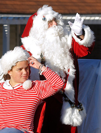 Brad Davis/The Register-Herald<br /> Santa made a stop in Fayetteville for their Christmas parade following Beckley's Saturday afternoon.