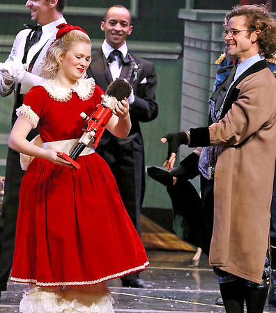 Brad Davis/The Register-Herald<br /> Clara, played by Presley Peterson, receives the nutcracker doll from Uncle Drosselmeyer during Beckley Dance Theatre's The Nutcracker Sunday afternoon inside the Woodrow Wilson High School Auditorium.