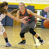 Brad Davis/The Register-Herald<br /> Summers County's Brittney Justice tries to get around Shady Spring's Kristen Miller during the Lady Bobcats' win over the Tigers Thursday night in Shady Spring.