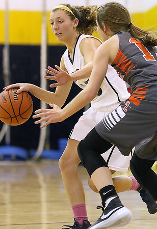 Brad Davis/The Register-Herald<br /> Shady Spring's Brianna Bevil looks for an open teammate as she dribbles during a home game against Summers County December 3.