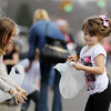 Emily Vannatter, 5, right, from Mabscott, and Lillie Villenave, 12, race to pick up candy thrown during the annual Sophia Christmas parade on Saturday. There were around 20 different entrees into the parade.