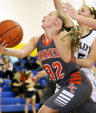 Brad Davis/The Register-Herald<br /> Summers County's Whittney Justice drives to the basket during the Lady Bobcats' win over the Tigers Thursday night in Shady Spring.